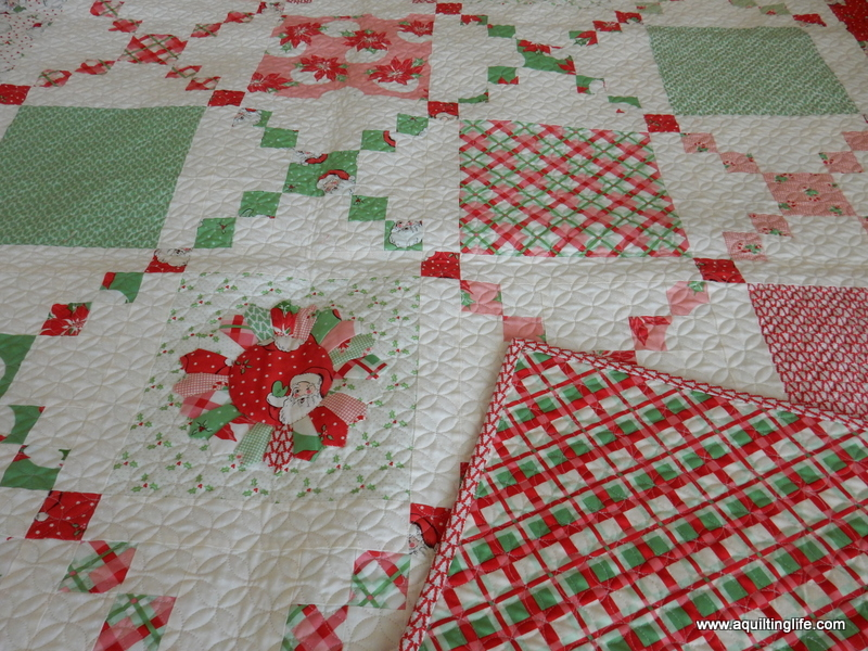 The Pot Luck pattern really lets the fabric shine in this quilt…and the Dresden plate blocks add even more to the already cute designs in the fabric .